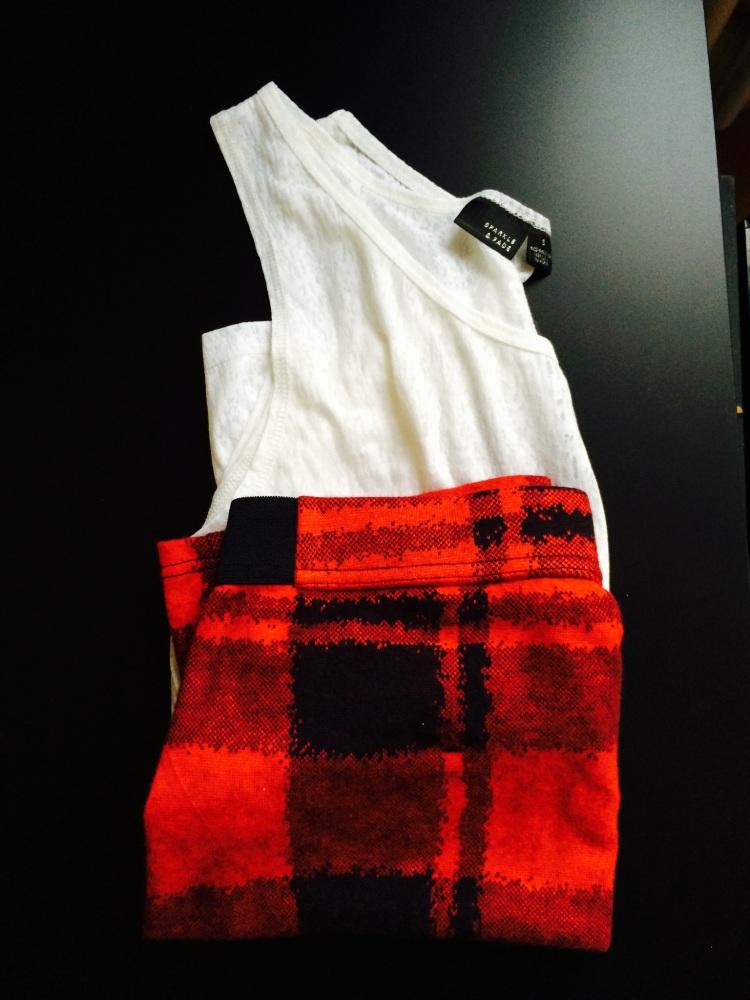 All Urban Outfitters: White sleeveless top - €6 / Tartan skirt - €19
