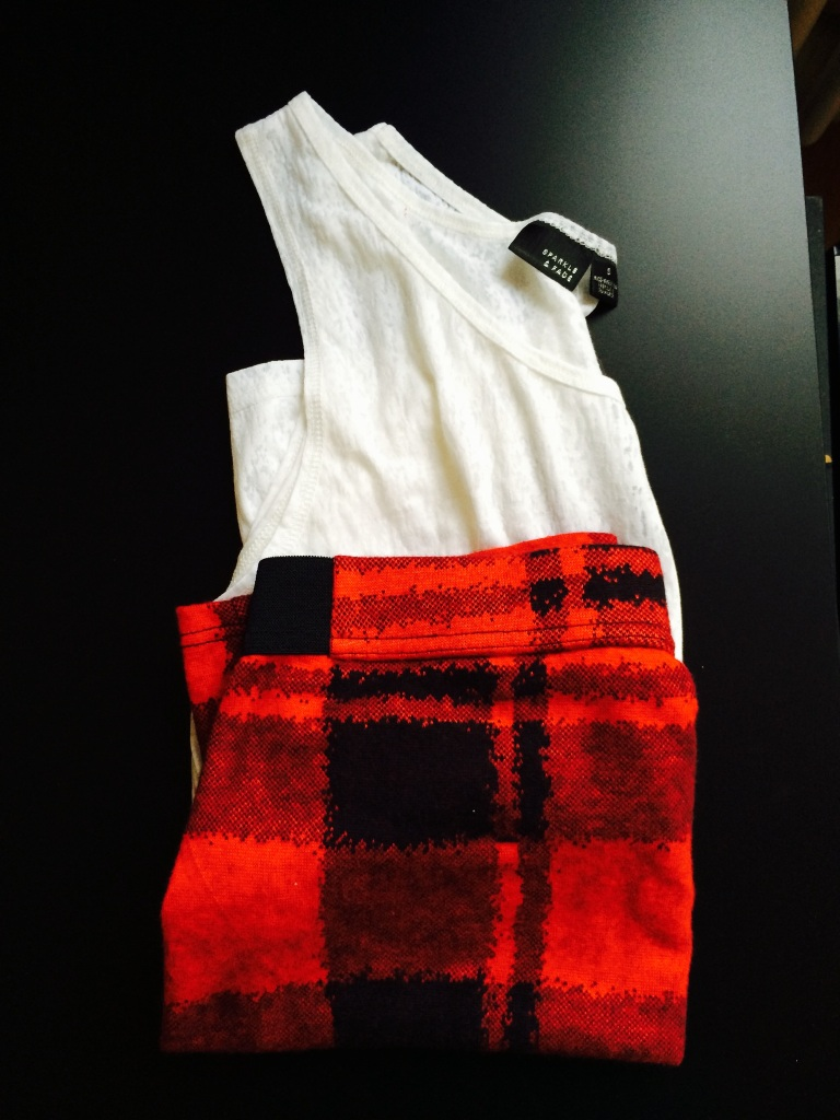 All Urban Outfitters: White sleeveless top - €6 / Tartan skirt - €19