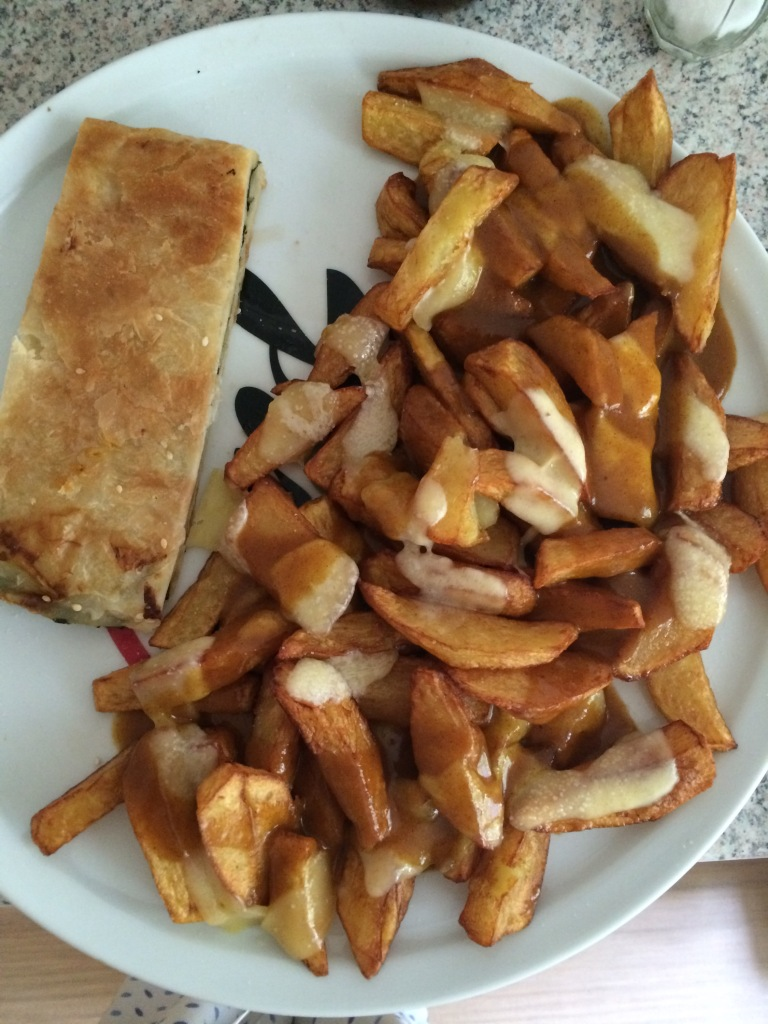Homemade chips and curry with spinach and feta borek.