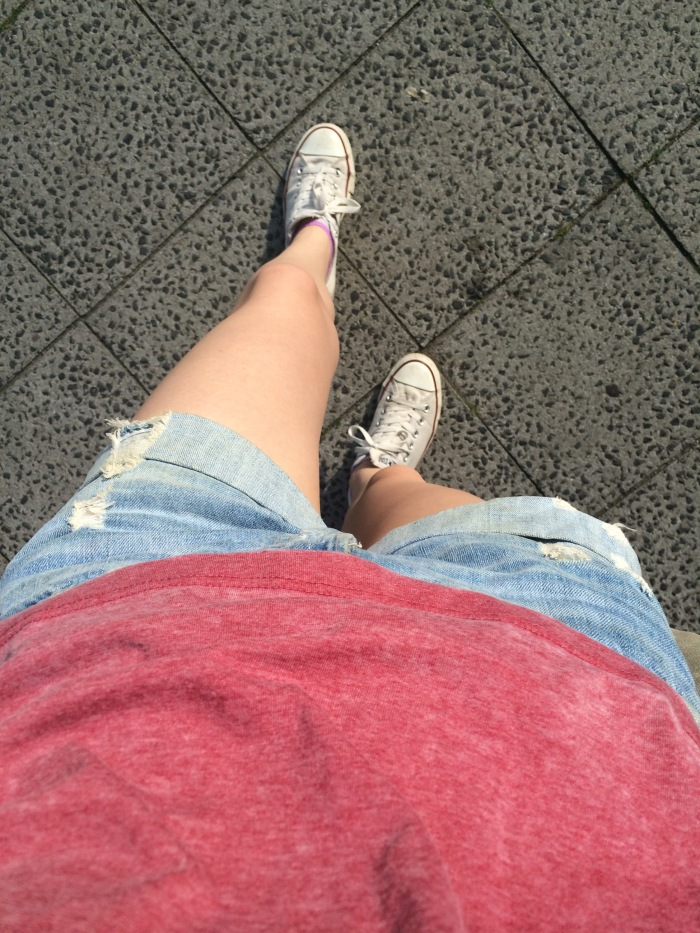 Ripped denim shorts from H&M, Coca Cola top from Penneys and Converse